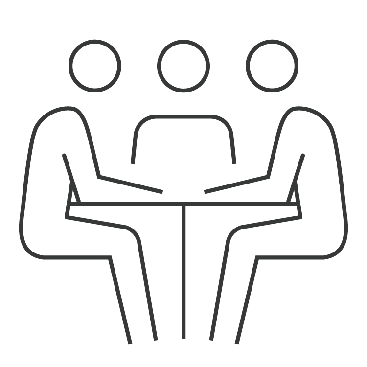 People in a meeting room at table