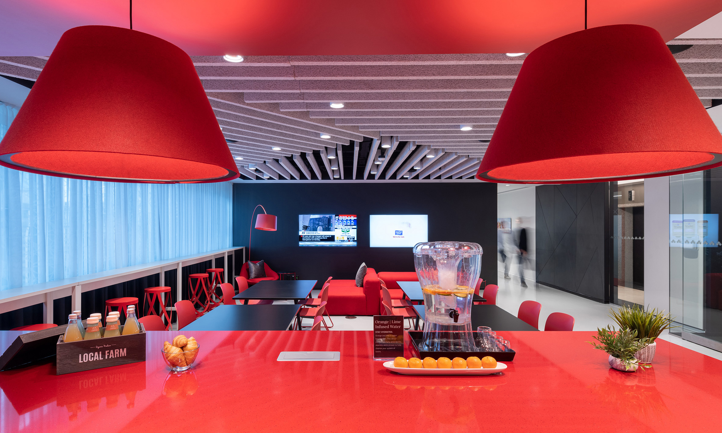 office lounge with seating area, kitchen and beverages
